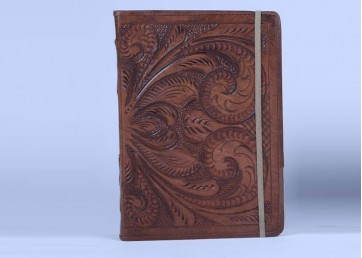 Leather hand tooled notebook with strap  and handmade paper inside